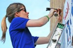 Alli Job helps build a house with Habitat for Humanity