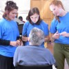 Students chat with a patient at the Laguna Honda Hospital