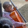 Cello student Patrick McGuire with a youngster