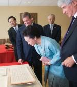 Peng Liyuan looks at manuscripts