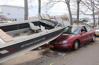 boat smashes into parked car