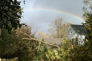 Rainbow appears over damaged house