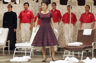 Soprano Hyesang Park as Fiorilla and chorus members in Rossini's Il Turco in Italia