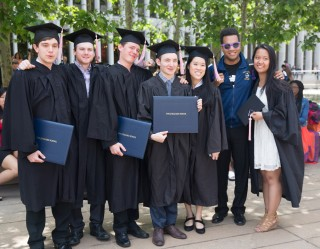 Juilliard students pose with diplomas